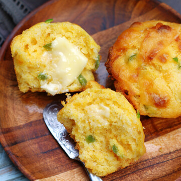 Cheddar Jalapeno Cornbread Muffins with butter on them