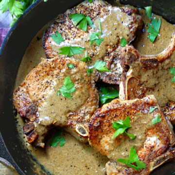 Pork Chops & Mustard Cream Sauce in a cast iron skillet