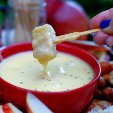 Dipping bread into Apple Cheese Fondue