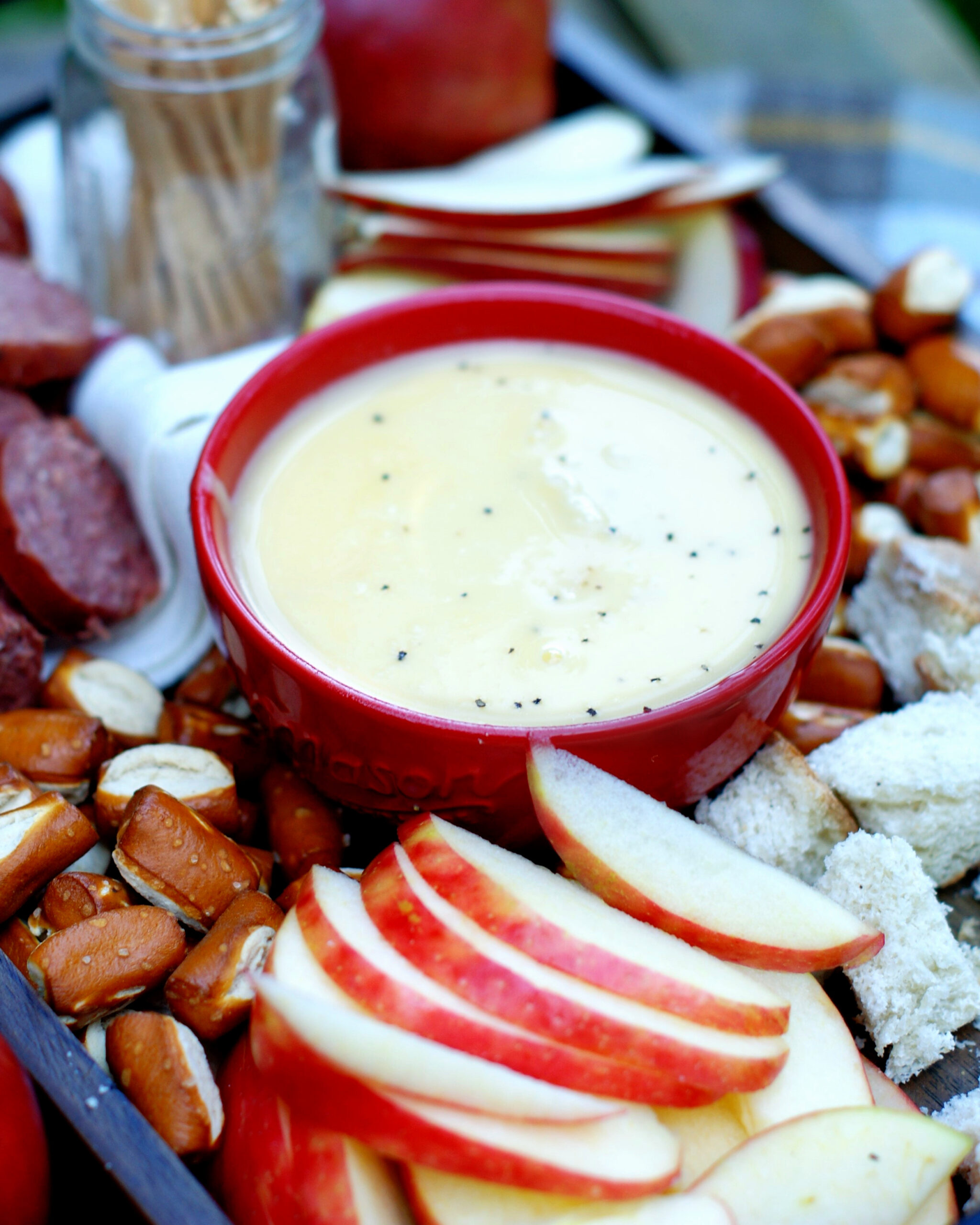 Apple Cider Cheese Fondue with apples & pretzel dippers