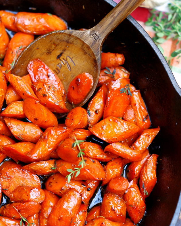 Honey Glazed Garlic Butter Carrots in a skillet