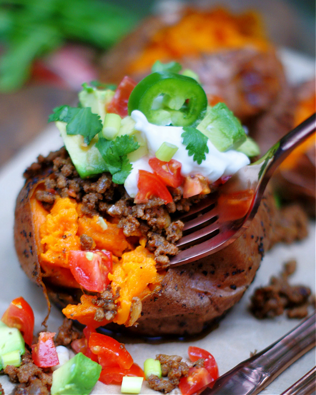 a forkful of Taco stuffed sweet potatoes