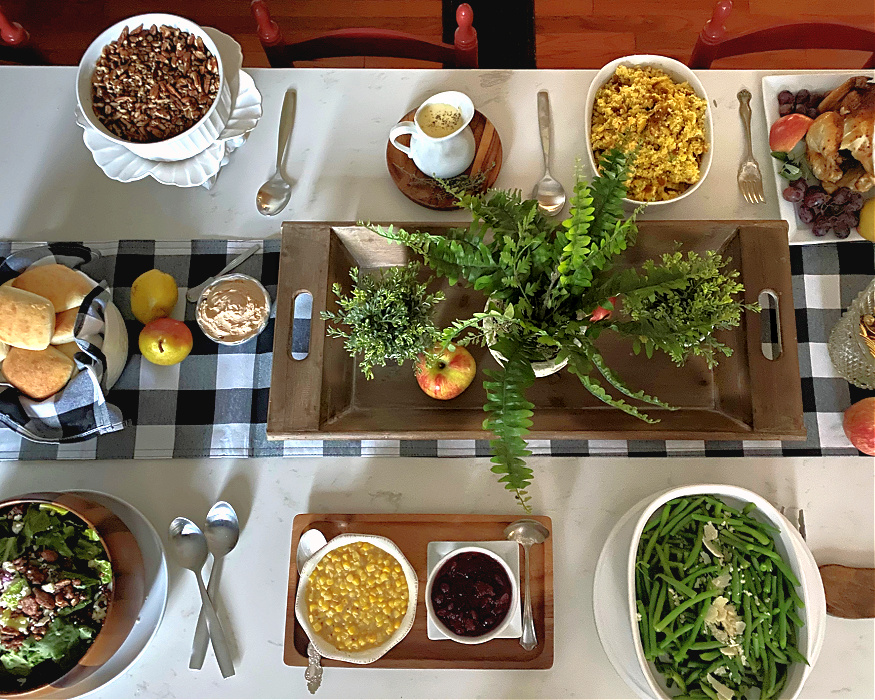 Overhead of set buffet table with spaces between the dishes