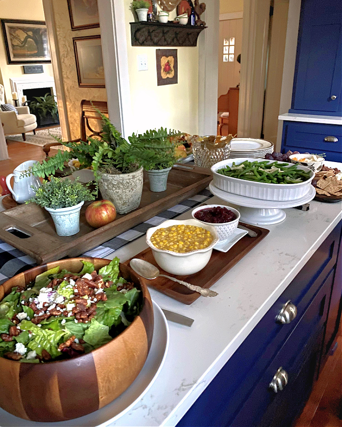 Layering pedestals and dishes creates varying heights on your buffet.