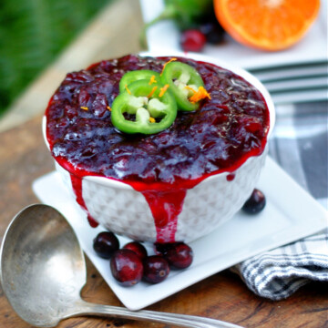 A full bowl of homemade cranberry sauce with orange and jalapeno