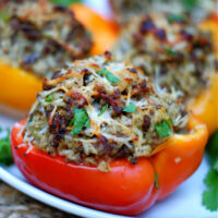 Red Bell Pepper stuffed with Louisiana Dirty Rice and topped with Parmesan