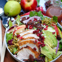 apple, pear, pomegranate salad with chicken and avocado with pomegranate vinaigrette