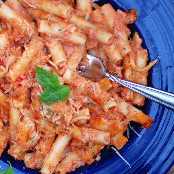 A close up of a bowl baked ziti without ricotta cheese