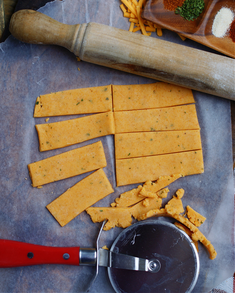 Cheese straw dough rolled out and cut into strips to bake