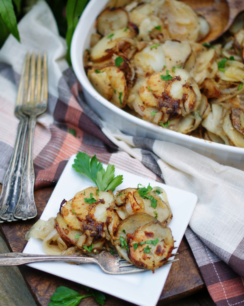 Lyonnaise Potatoes on a plate and in a serving dish.