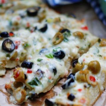 Stuffed Olive Cheese Bread with green and black olives.