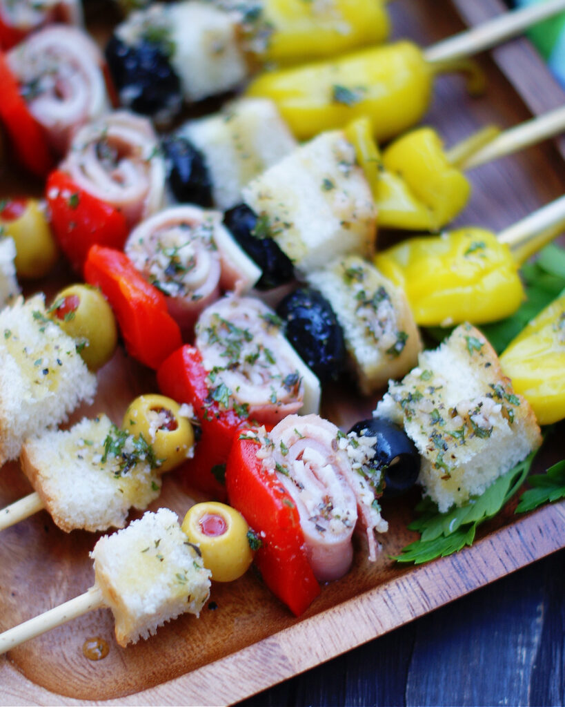 Up close of a muffuletta kabob appetizer