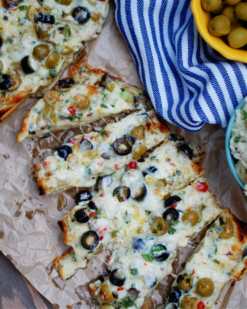 Stuffed Olive Cheese Bread sliced as an appetizer.