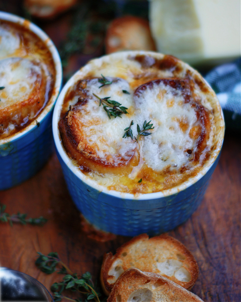A classic comfort food recipe of carmelized onions, rich broth, oodles of melted cheese & crusty bread.