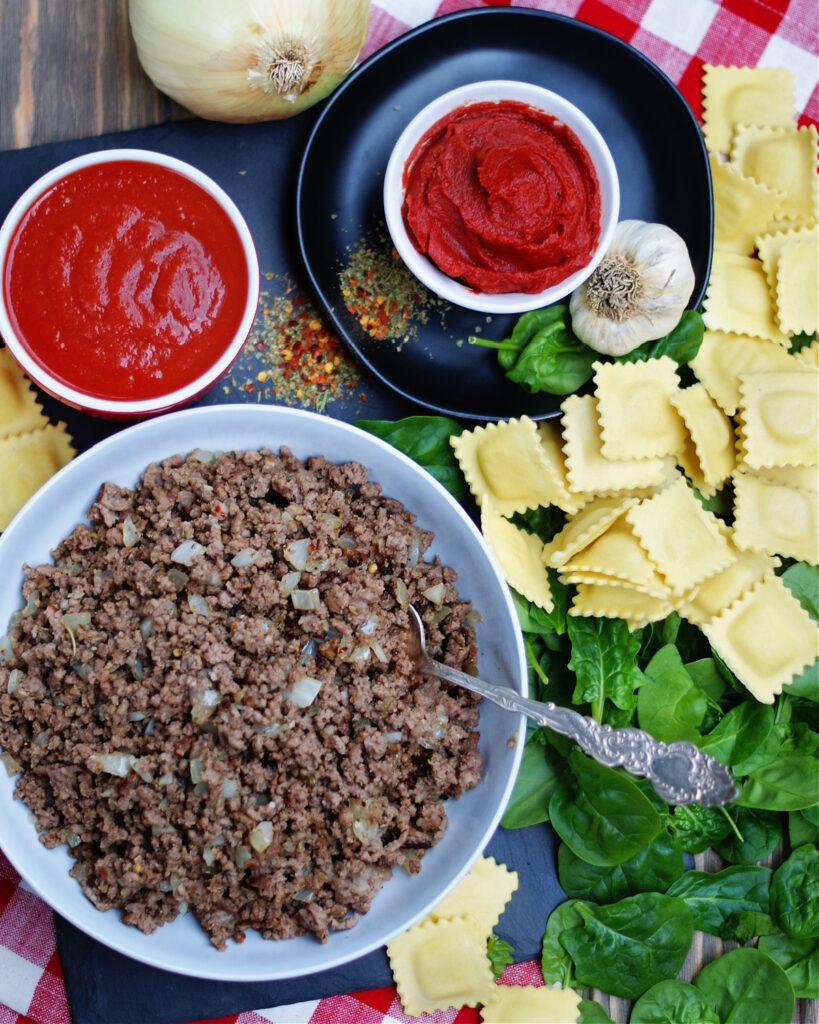 the ingredients to make one dish baked ravioi with meat sauce