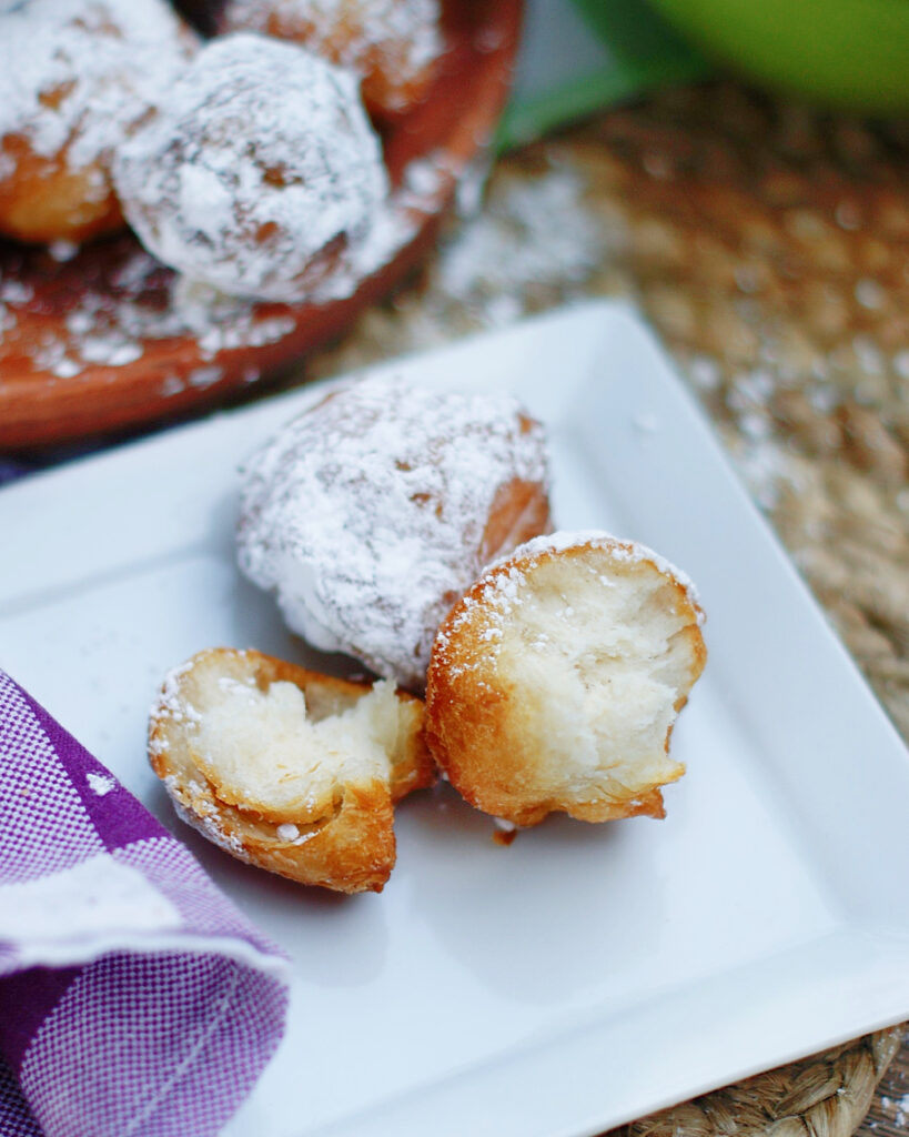 The inside of a biscuit beignet is soft and fluffy, but not as sweet as a douhgnut.