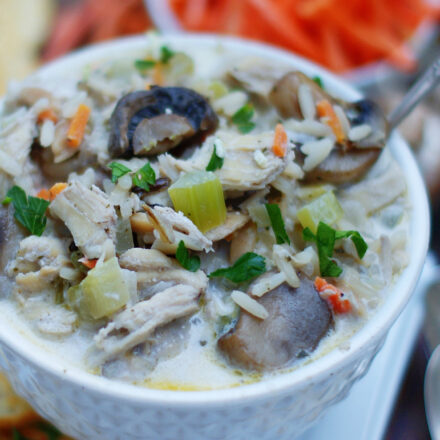 Chicken and Wild Rice Soup with Mushrooms is comfort food in a white bowl.