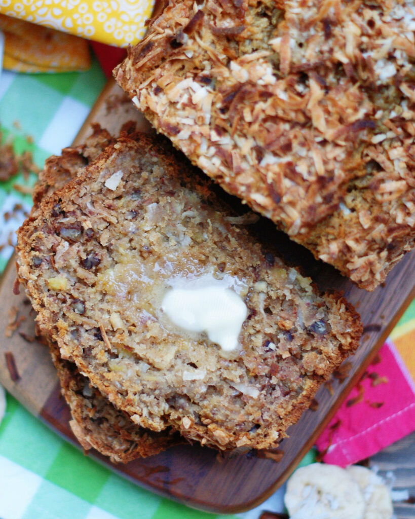 A slice of Hummingbird Banana Quick Bread with butter