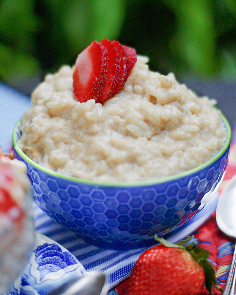 Creamy Old Fashioned Rice Pudding in a blue bowl