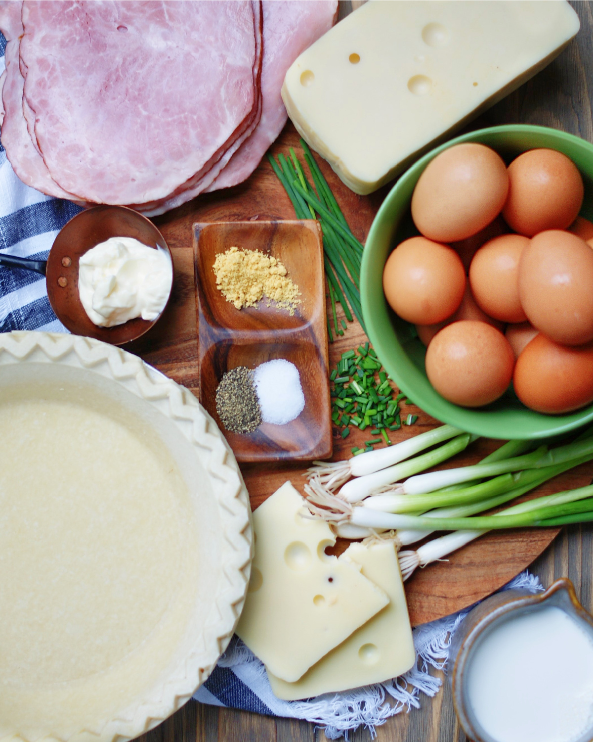Frozen pie crust, egg, swiss cheese, ham, green onions, mayonnaise and spices create a succulent quiche