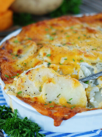 Rich cream sauce and a topping of cheese make a delicious scalloped potatoes side dish.