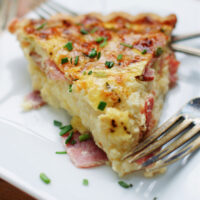 this classic ham & swiss quiche has one secret ingredient to make it silky and dreamy