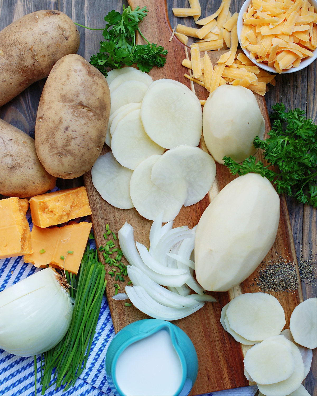 Ingredients for Scalloped Potatoes with cream sauce and cheddar cheese.