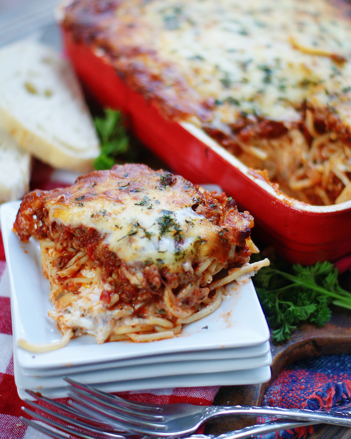 Ultimate Baked Spaghetti Casserole is a layered spaghetti recipe with a creamy cheese center.