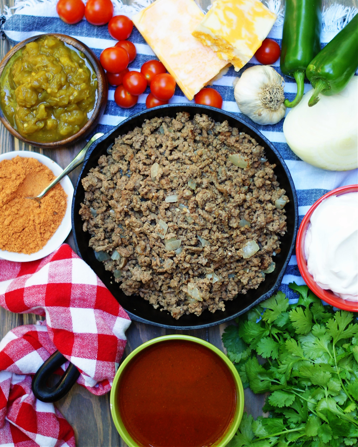Gound beef, red enchilada sauce and cheese are the main ingredients in this hot dip