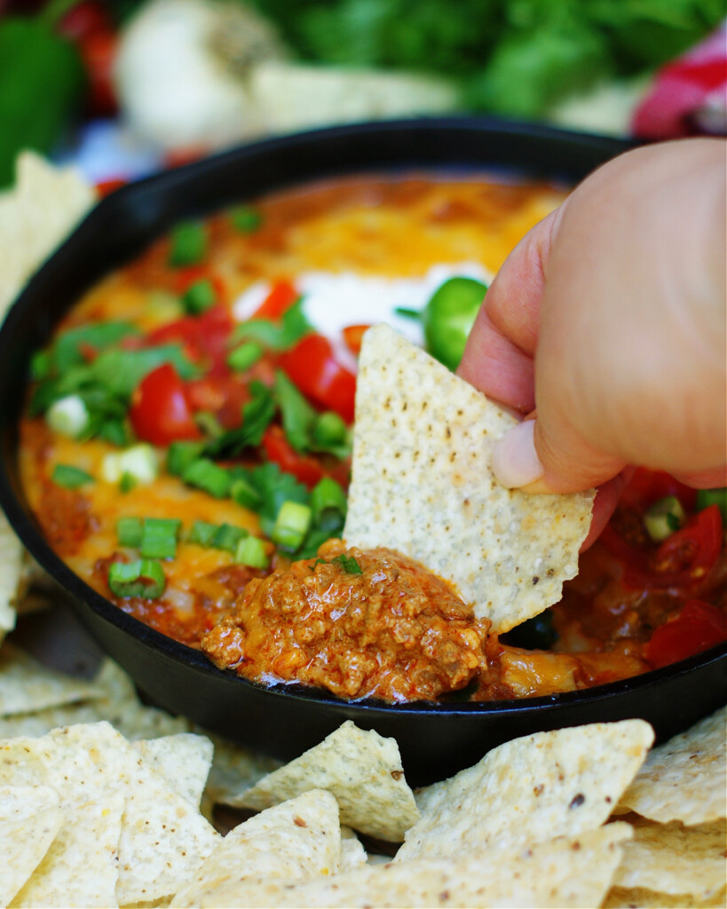 Scoop up Beef Enchilada Dip with chips or warm tortillas