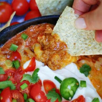 Serving Hot Enchilada Dip with tortilla chips