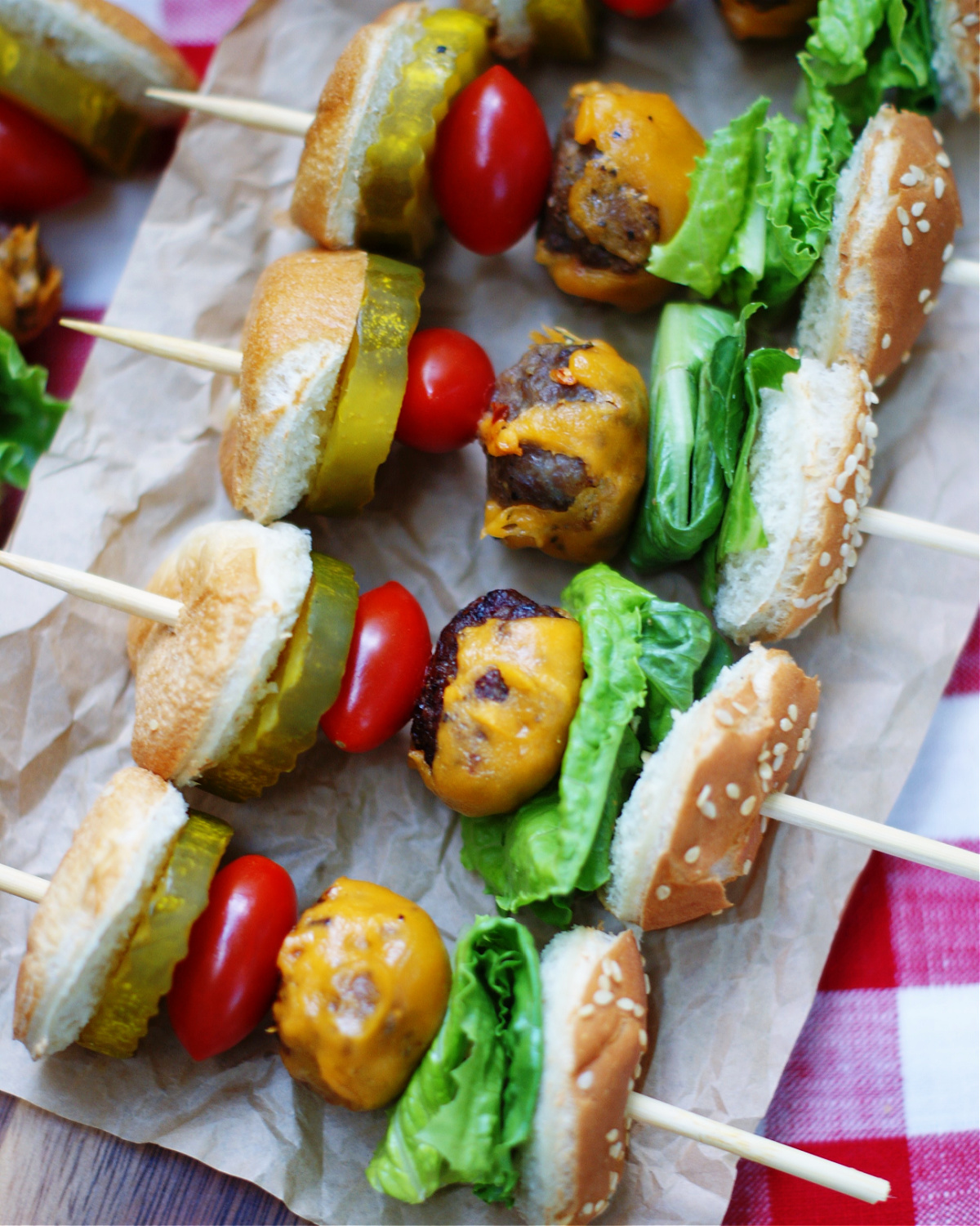 4 mini cheeseburger skewers to give another look at ingredients