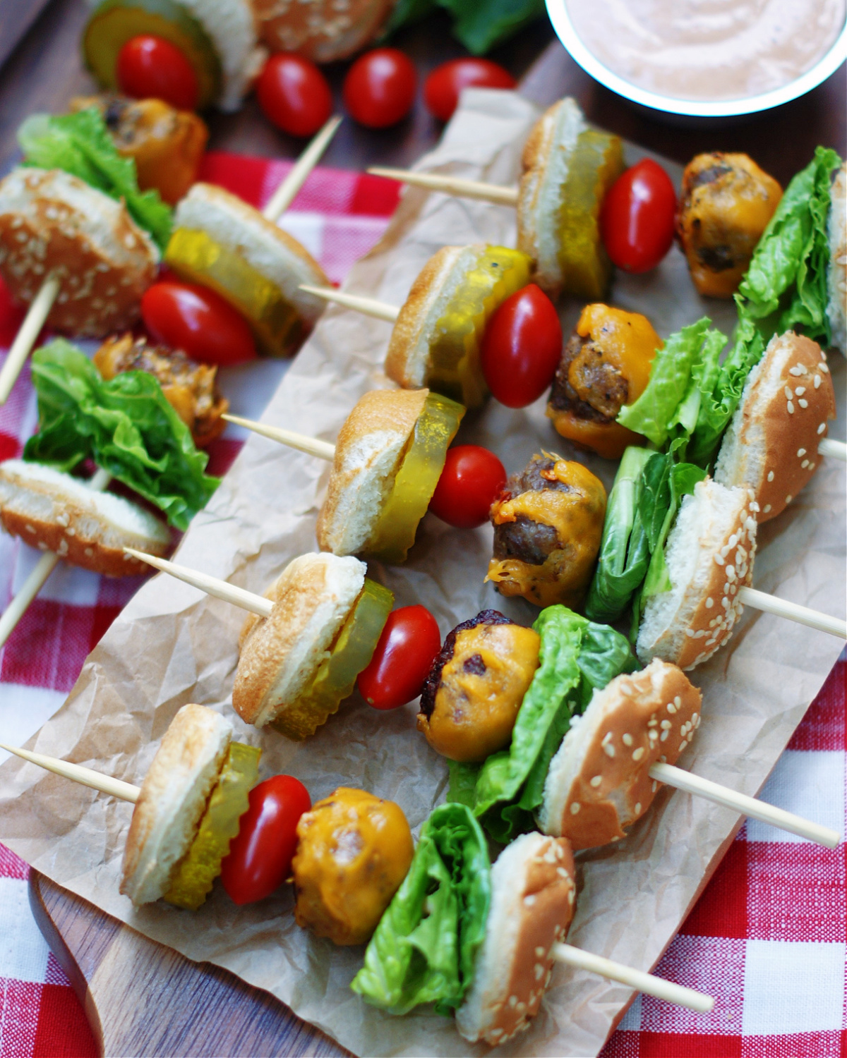a platter of cheeseburger skewers for a party