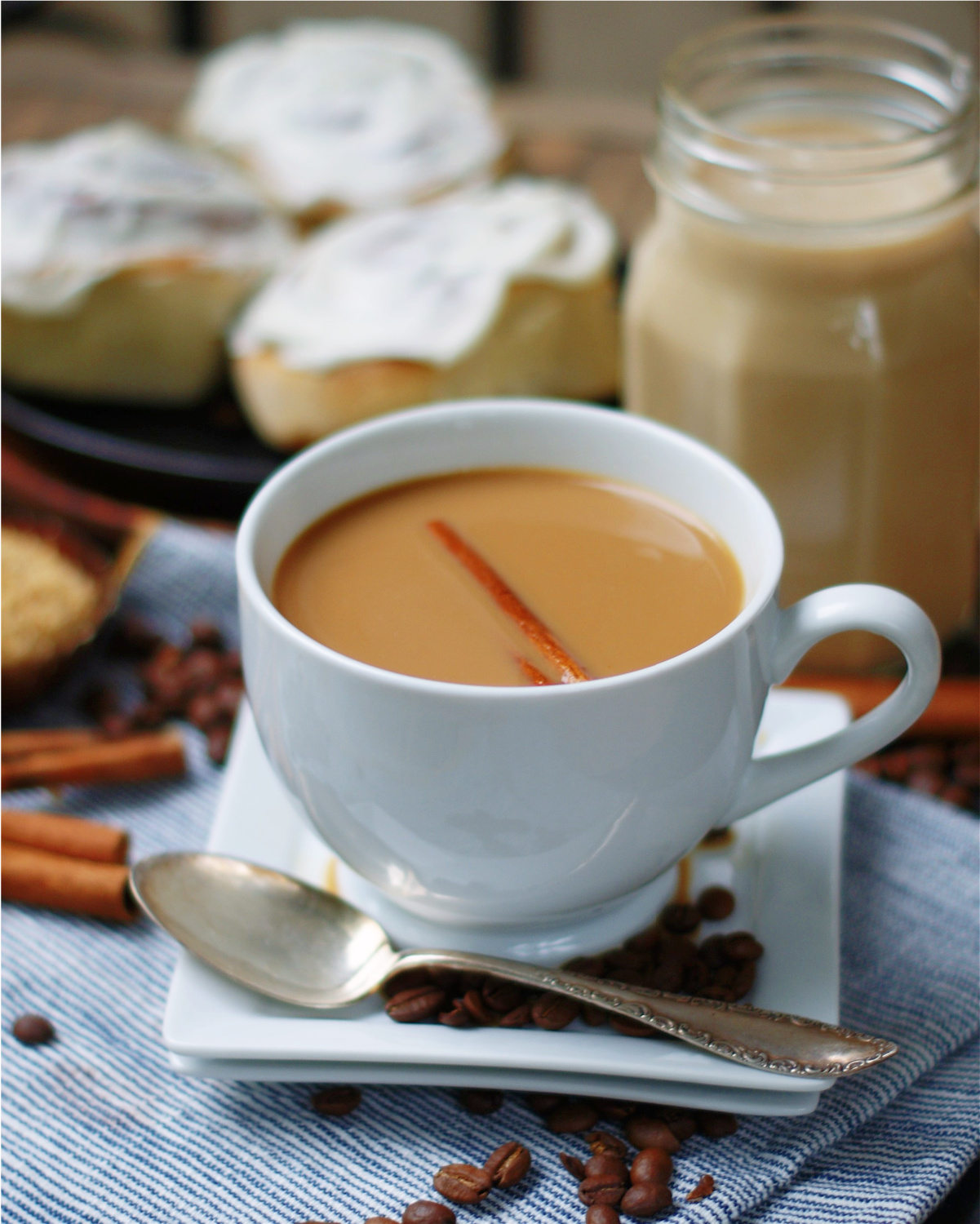 A cup of coffee with cinnamon roll coffee creamer