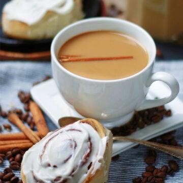 Cup of Coffee with Homemade Cinnamon Roll Coffee Creamer & a cinnamon bun
