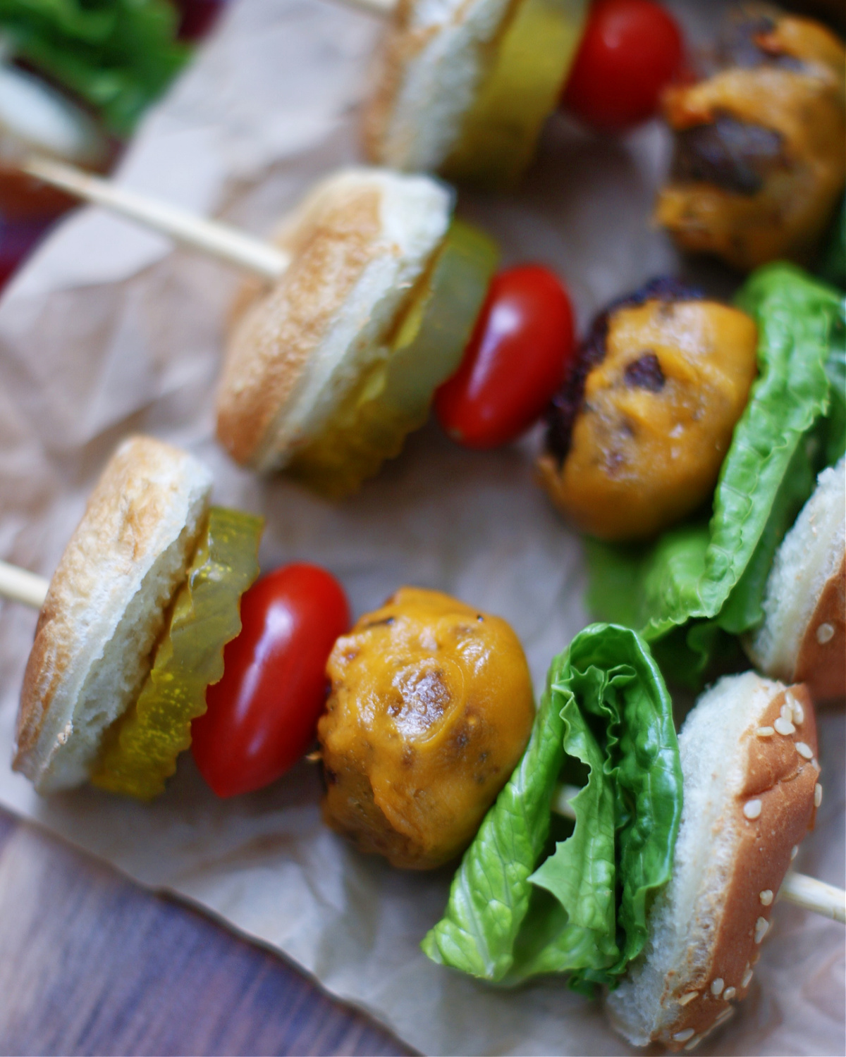 a close up of cheeseburger skewer to show ingredients