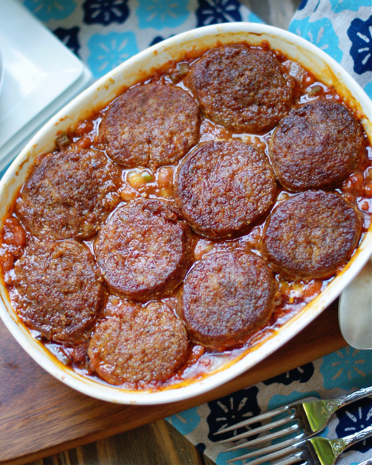Homemade Baked Beans with ground sausage patties on top