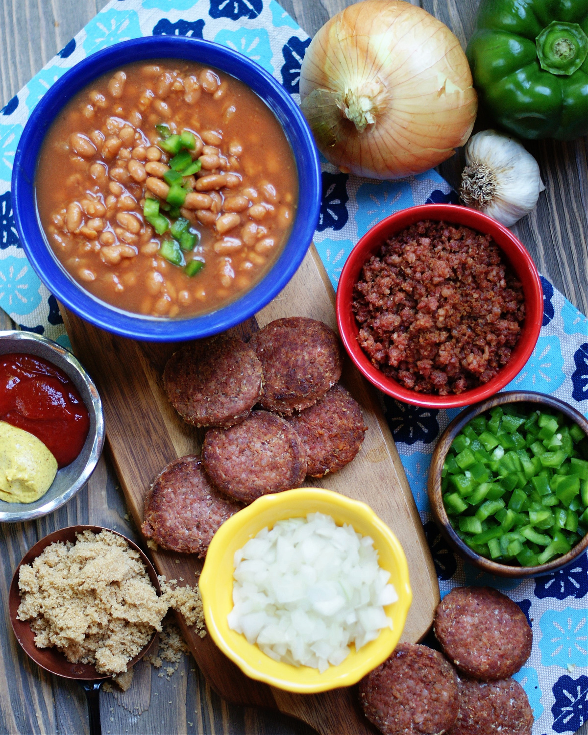 Ingredients needed to make baked beans and ground sausage