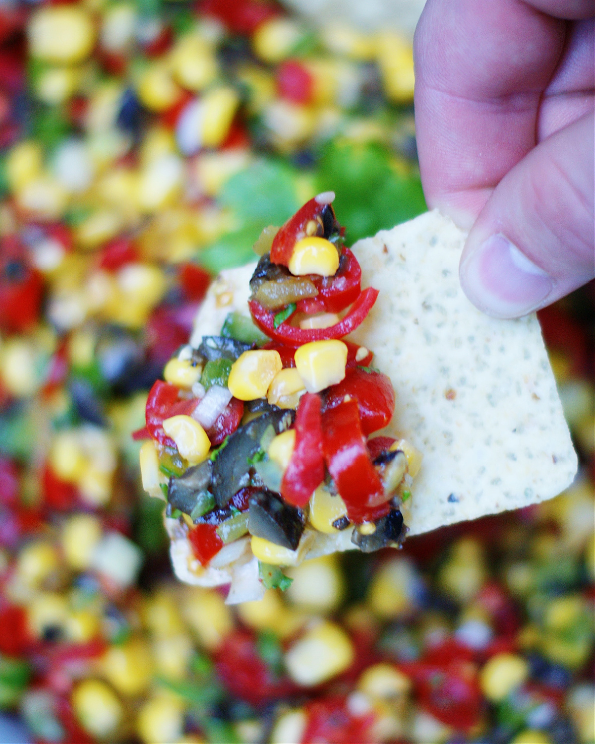 the best corn salsa dip on a chip as a serving suggestion
