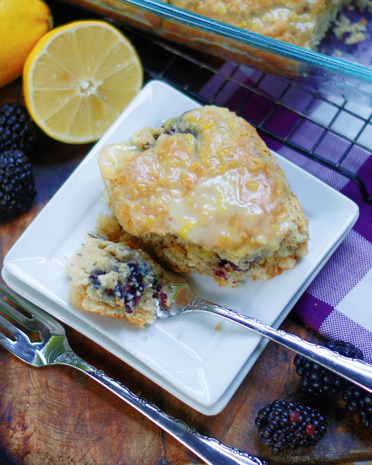 Warm, fluffy homemade buttermilk biscuits with blackberries and lemon glaze