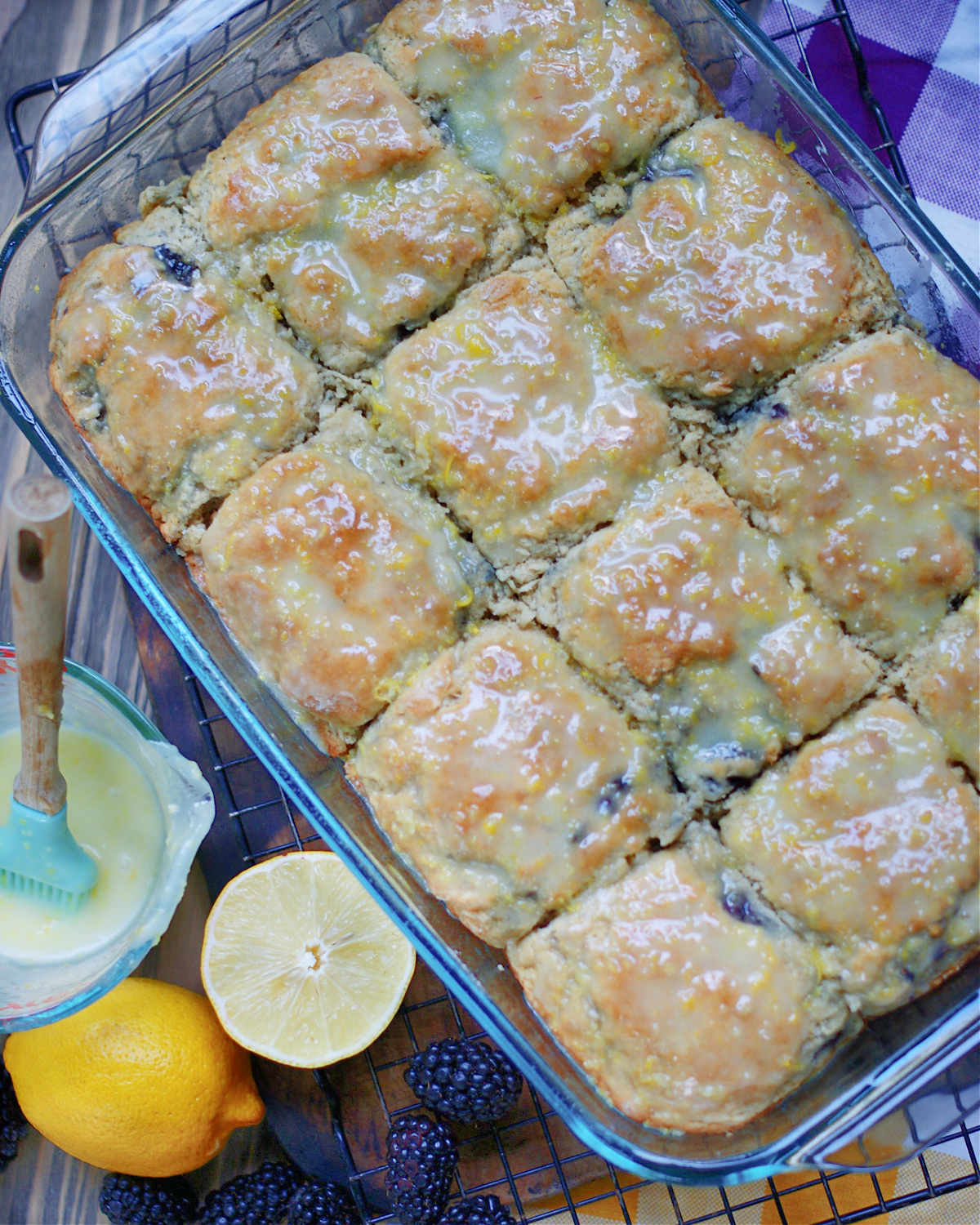 A pan of blackberry biscuits with lemon glaze