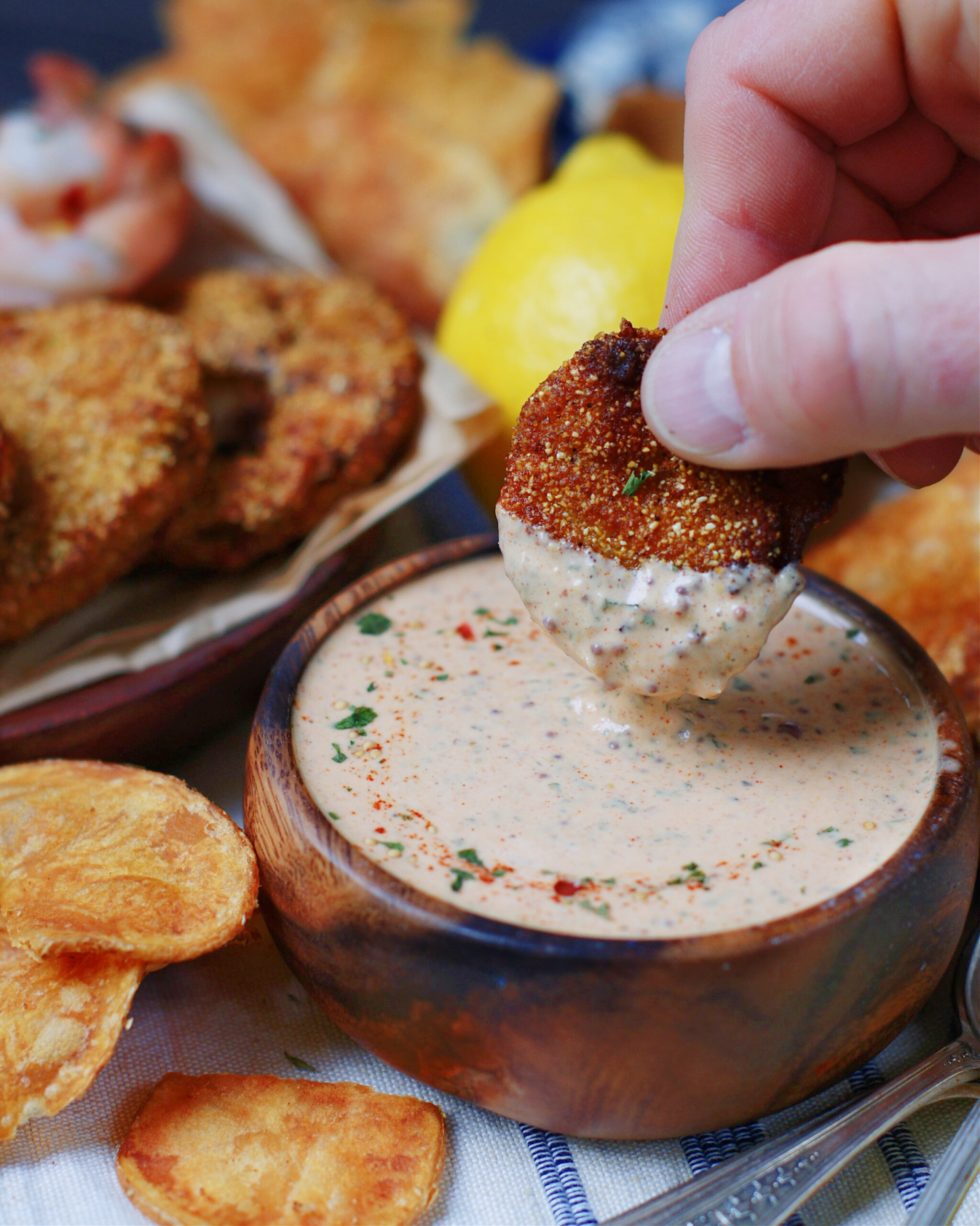 dipping in spicy Louisiana remoulade sauce for seafood