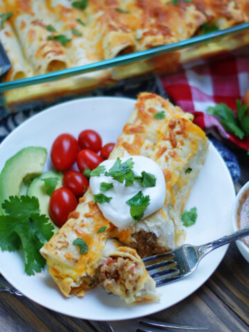 Overnight breakfast burrito casserole with sausage, egg and hashbrowns.