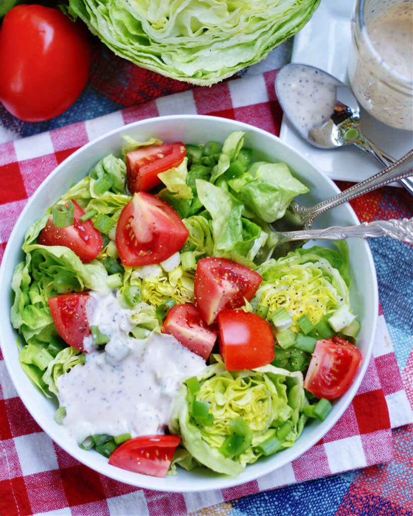 full shot of salad and dressing to that they are served together
