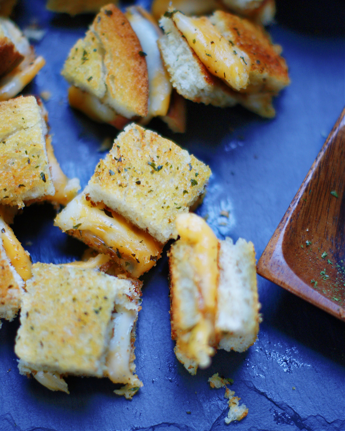 up close of grilled cheese croutons to show texture and ingredients