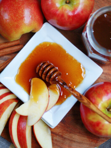 boiled apple cider honey on a plate with apples to show serving idea