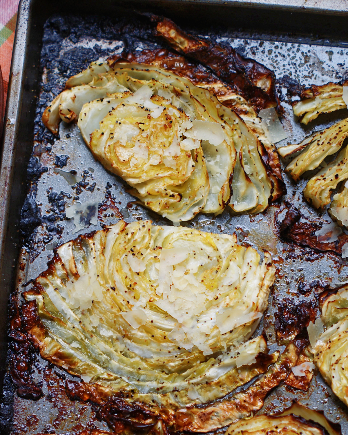 close up of beefy roasted cabbage steaks to show caramelization and seasoningsd