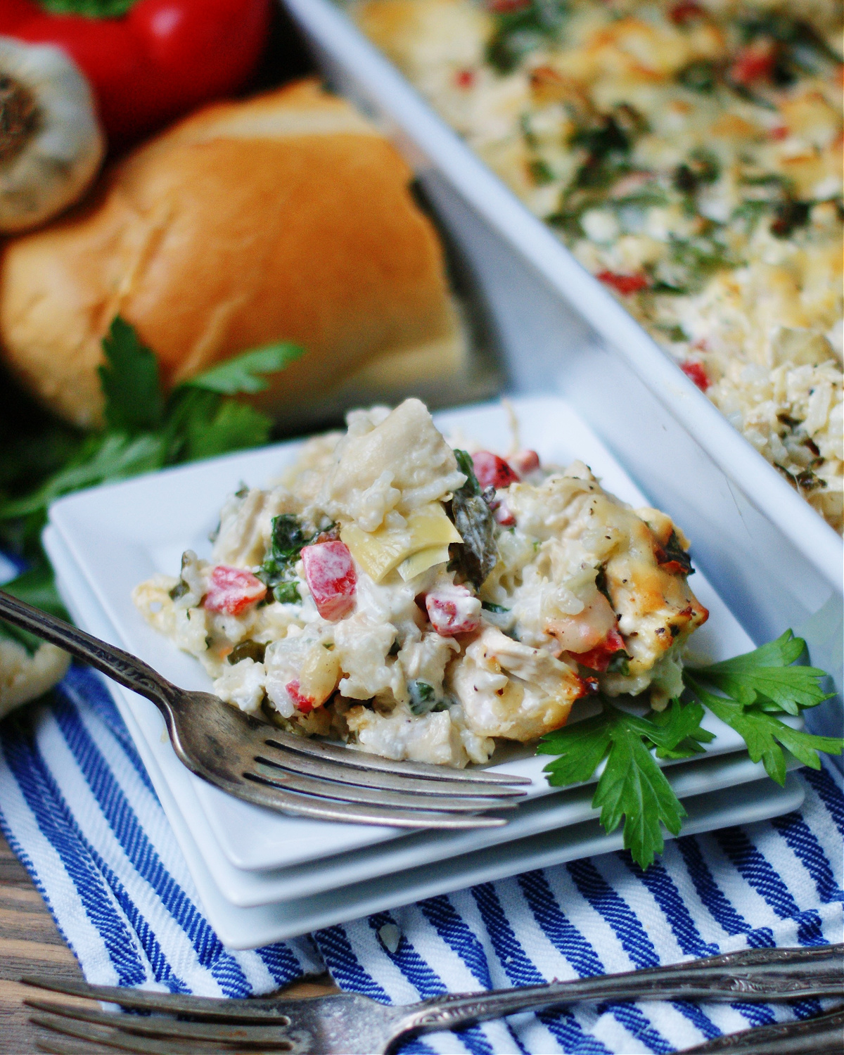 An example of how to serve creamy spinach artichoke casserole with rice as a meal
