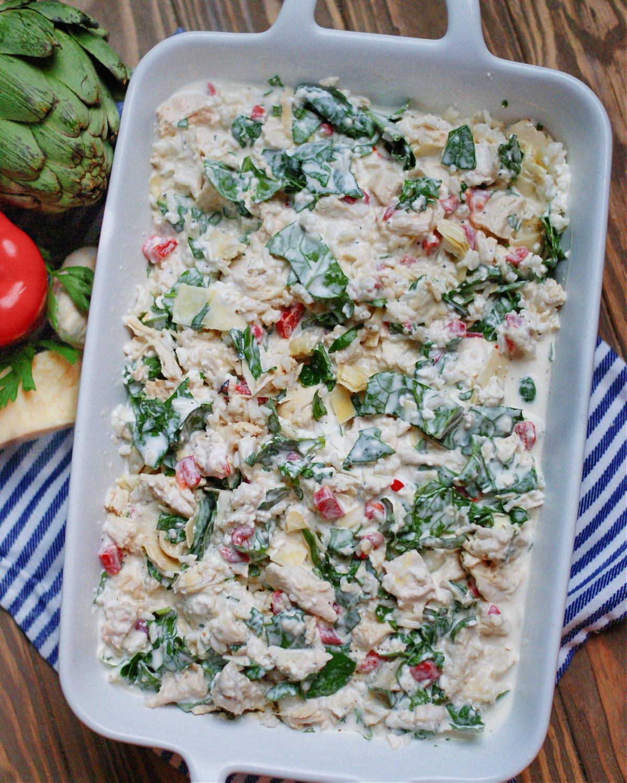 spinach artichoke casserole before baking